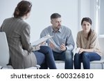 family therapist during meeting ... | Shutterstock . vector #600326810