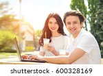 young couple sitting in a... | Shutterstock . vector #600328169