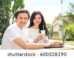 young couple sitting in a... | Shutterstock . vector #600328190