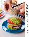 woman cooking healthy vegan... | Shutterstock . vector #600365168