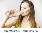 fitness female drinks water | Shutterstock . vector #600384776