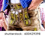 "close-up of a typical bavarian ""krachlederne"" - traditional clothing with antique coins - stock photo"