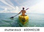 woman in bikini exploring calm... | Shutterstock . vector #600440138