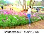 Blurred People Enjoy In Flower...