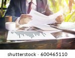 business man is pointing to... | Shutterstock . vector #600465110