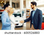 young couple shaking hands... | Shutterstock . vector #600526883