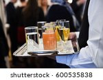 waiter holding a tray with... | Shutterstock . vector #600535838