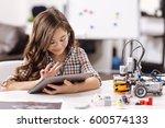 Amused Teen Girl Using Tablet...
