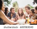 group of young people sitting... | Shutterstock . vector #600583040