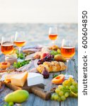 picnic on the beach at sunset... | Shutterstock . vector #600604850
