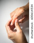 Small photo of Woman finger with adhesive bandage