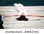 Young Girl Dabble In Water By...