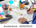 male designer working in office | Shutterstock . vector #600639653