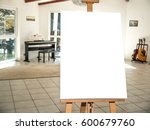 white canvas on a wooden easel... | Shutterstock . vector #600679760