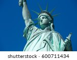 statue of liberty  blue sky in... | Shutterstock . vector #600711434