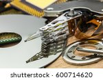 Small photo of platter, actuator arm and axis with actuator of disassembled HDD with in PC service
