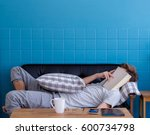 man sleeping on old sofa with... | Shutterstock . vector #600734798