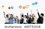 diverse group of kids holding... | Shutterstock . vector #600752318