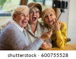 Women Taking Selfie At Table....