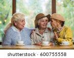 smiling elderly ladies in cafe. ... | Shutterstock . vector #600755558
