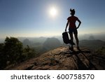 young woman backpacker enjoy... | Shutterstock . vector #600758570