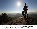 young woman backpacker enjoy... | Shutterstock . vector #600758570