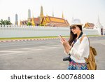 asian woman outside on checking ... | Shutterstock . vector #600768008
