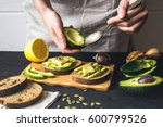 making sandwiches with avocado... | Shutterstock . vector #600799526