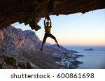 male rock climber gripping... | Shutterstock . vector #600861698