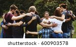 group of people huddle together ... | Shutterstock . vector #600903578