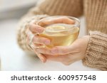 closeup view of woman holding... | Shutterstock . vector #600957548