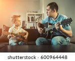 father teaching his son to play ... | Shutterstock . vector #600964448