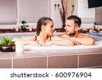 beautiful young couple relaxing ... | Shutterstock . vector #600976904