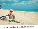 cute little girl on tropical... | Shutterstock . vector #600977873