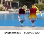 Two Cocktails By The Pool