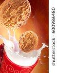 delicious cookies falling into...   Shutterstock . vector #600986480