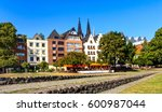 Small photo of Picturesque houses in the old town on the Rhine river in Cologne, Germany
