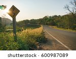 sunset at countryside road with ... | Shutterstock . vector #600987089