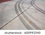 tire tracks  mark. traces of... | Shutterstock . vector #600992540