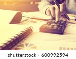 calculator with hand woman... | Shutterstock . vector #600992594