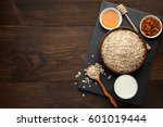 oat flakes in the bowl and... | Shutterstock . vector #601019444