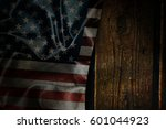 usa flag on a wood surface | Shutterstock . vector #601044923