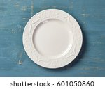 white empty plate on blue... | Shutterstock . vector #601050860