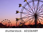 Silhouettes Of Carnival Rides...