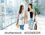happy young asian women shopping | Shutterstock . vector #601068104