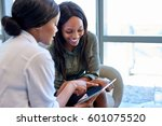 two smiling young business... | Shutterstock . vector #601075520