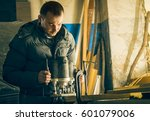 man doing some carpentry work... | Shutterstock . vector #601079006