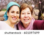 outdoor portrait of two 45... | Shutterstock . vector #601097699
