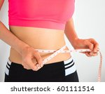 slim young woman body weight... | Shutterstock . vector #601111514