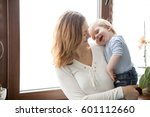 mother and son beeing toghether.... | Shutterstock . vector #601112660